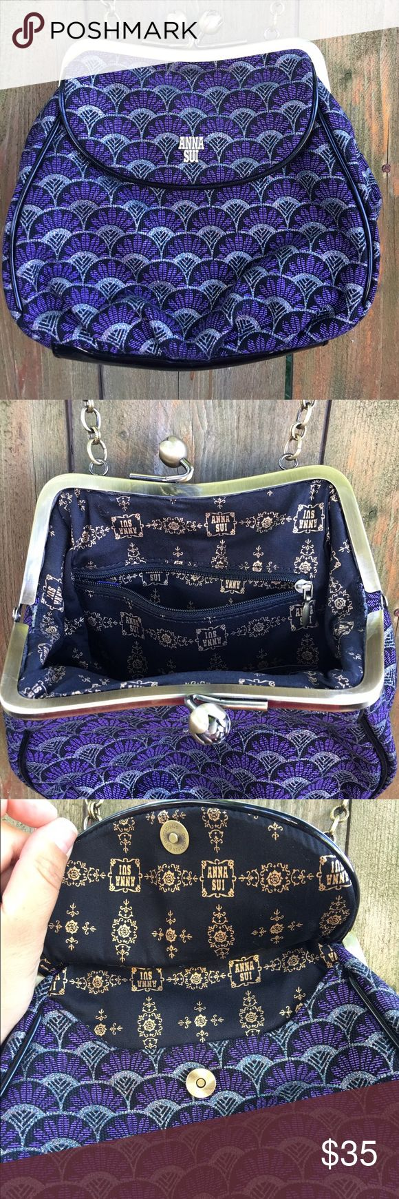 Anna Sui Purse / Handbag Purple, black and silver patterned Anna Sui small handbag / purse with chain handle and snap top closure. Front pocket with magnetic snap and zipped pocket. Anna Sui logo lining. Anna Sui Bags