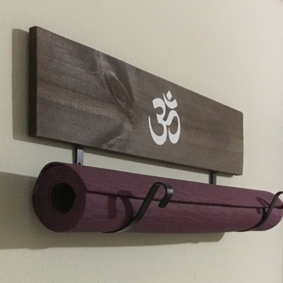 This listing is for one yoga mat holder. The yoga mat holder is made of painted wood with metal hooks to be connected to the wood to hold