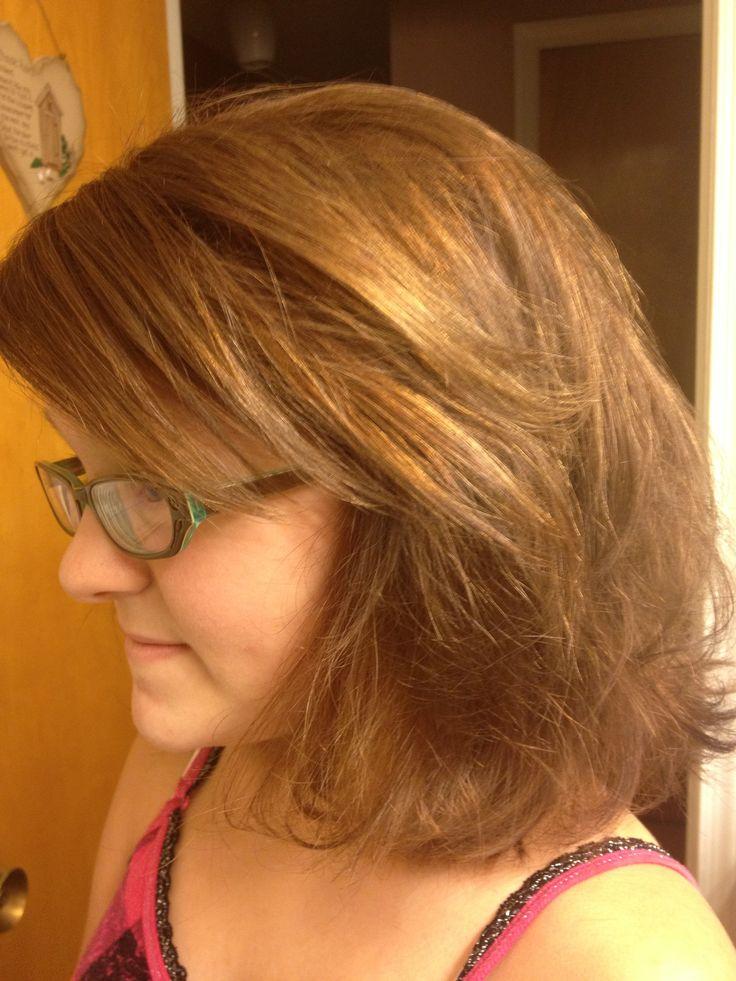 Razored layered haircut with side sweep bang