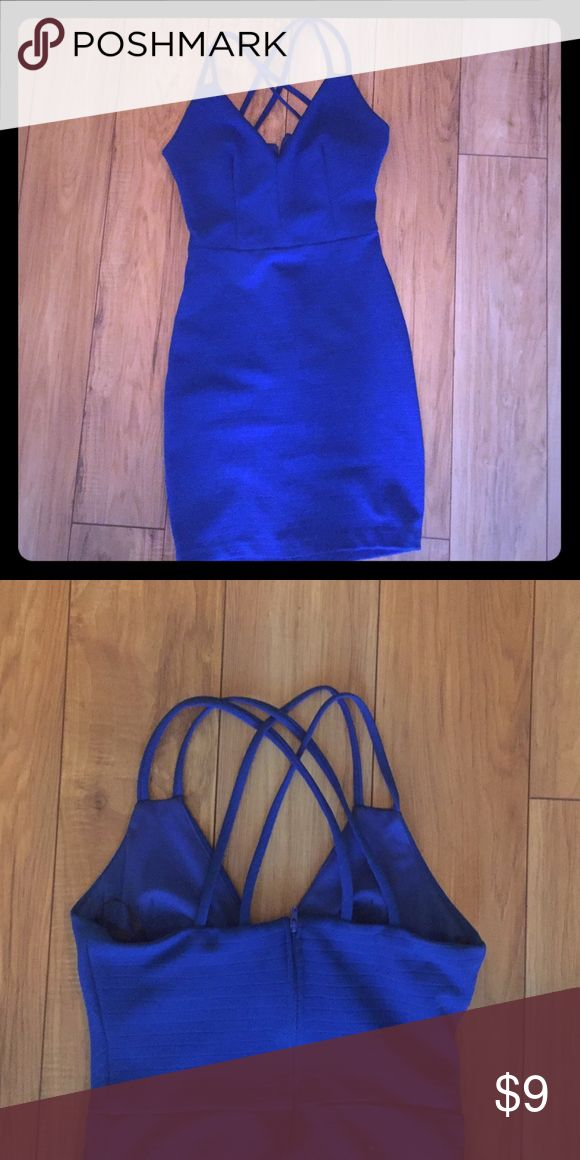 Royal blue, strappy, body con dress Body con, two spaghetti straps and strappy in the back, zips up the back, V neck, royal blue B. Smart Dresses Mini
