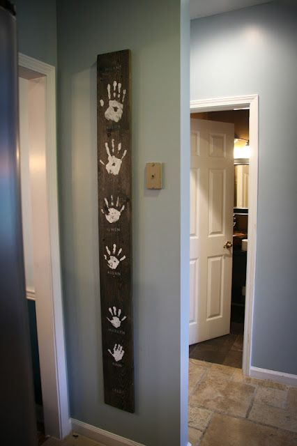 Family Hands Wood Wall Art.... I would add a shorter one beside with our dog's paw prints