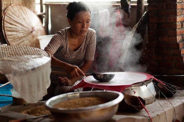 Local woman spooning pancake mix, by Jo Stevens, Mekong Delta - Vietnam - Around the World