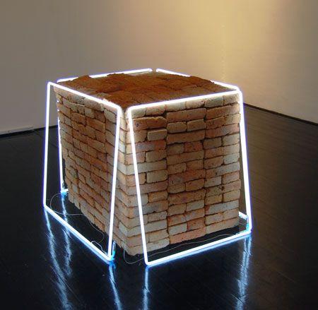 Jose Davila. Untitled, 2010. Red bricks, neon light.