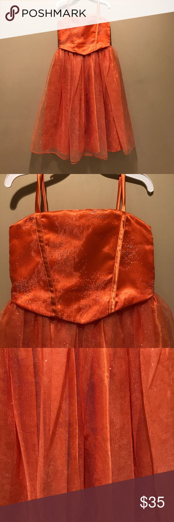 Girls Party Dress size 4 Girls Party Dress size 4 in a lovely orange with sparkly accents.  Perfect for a party, formal, or dress-up. Dresses