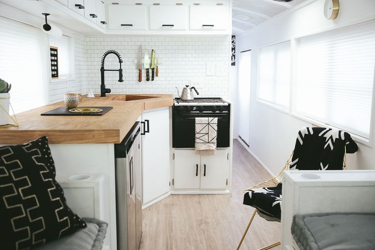 School bus home - For the L-shaped kitchen, the Mayes' chose an under-counter fridge/freezer unit so as to have more counter space. The 23-inch Vigo sink is deep enough to bathe a baby or hide dirty dishes.