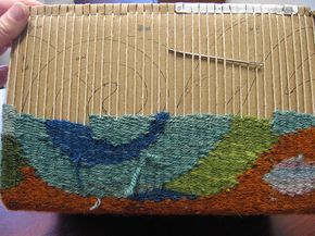 Day 12  (This project is following the instructions for a tapestry box or bag woven on a cardboard box, as written by the marvelous Sarah Swett in the Jan/Feb 08 edition of Handwoven magazine.)