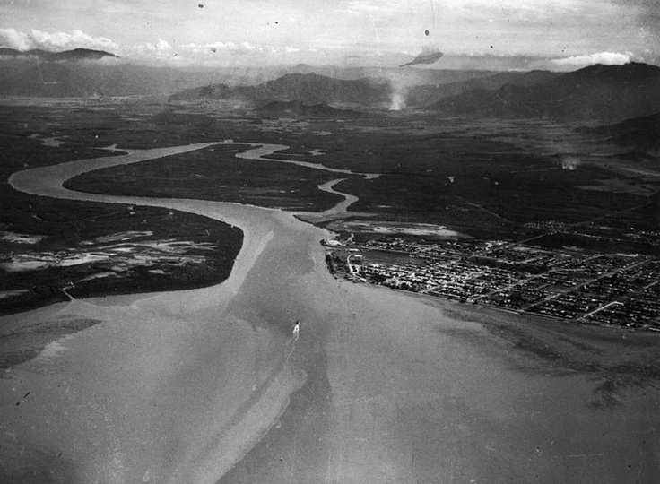 Aerial view of the City of Cairns, November 1937. Photograph shows the  Trinity Inlet and the ranges behind.