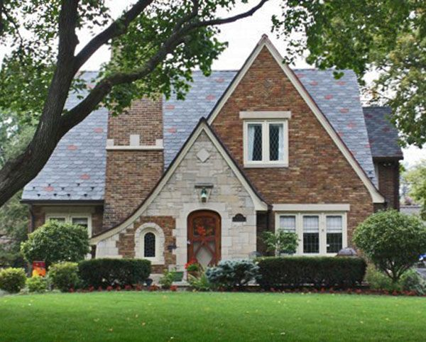 Why Tudor Style Is A Great Fit For Small Homes The Modest Mansion Tudor House Exterior Cottage Style Homes Tudor Style Homes