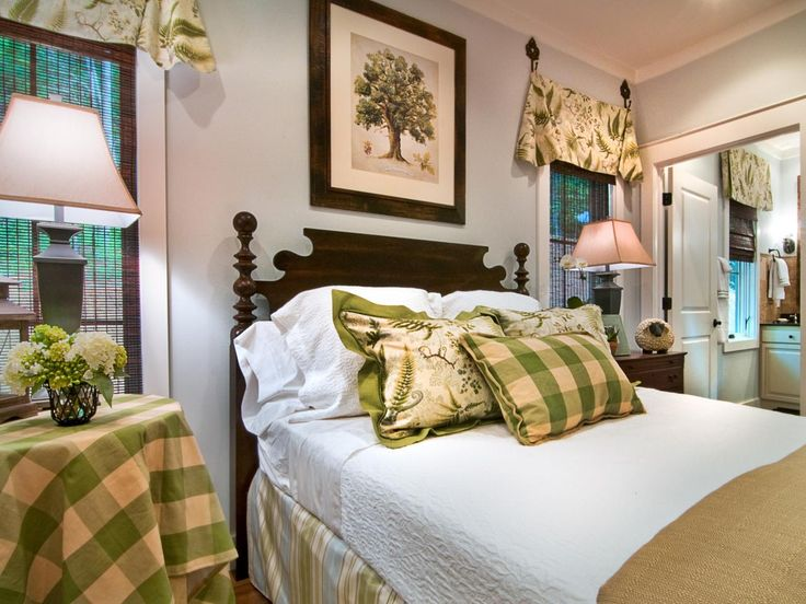 An heirloom-quality, four-poster bed grounds the bright and airy space. Decorative iron hooks, which mirror the shape of the bed posts, replace traditional curtain rods.