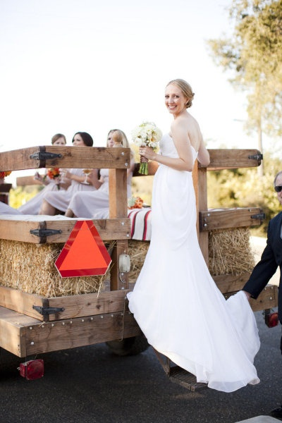 We're carrying our wedding party around our farm on a wagon to take wedding photos. Presh idea, riiight?
