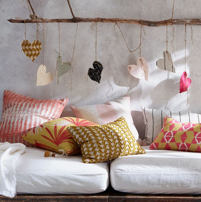 Pillow play for Tonic Living www.tonicliving.com #justinablakeneyhome #pillowplay  #bohocozy #modernboho #driftwoodwallhanger #hanginghearts #havethisthingwithpillows #cottontassels #dipdyedtassel