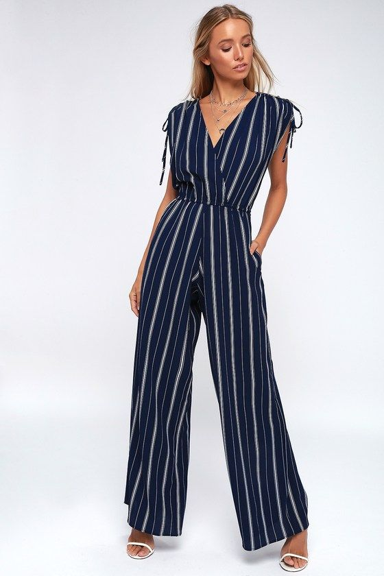 0b50171d9293 We aren t going anywhere without the Lulus Cartagena Navy Blue and White  Striped Wide-Leg Jumpsuit! The plunging V-neck bodice