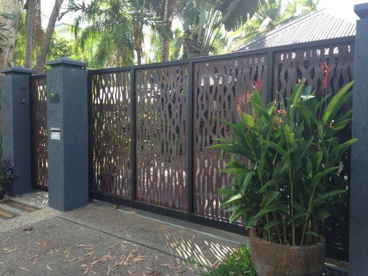 Palm Cove Front Gates Covered With Vine Design Metal Rust