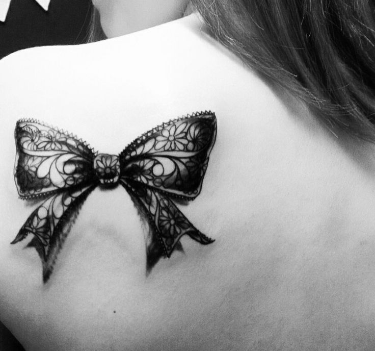 lace bow tattoo on the back