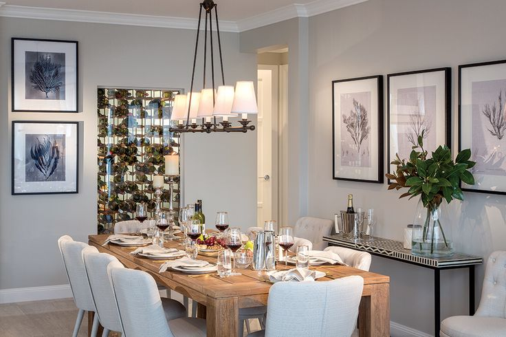 Dining room with wine cellar on the Astor Grange with Classic Hamptons World of Style.