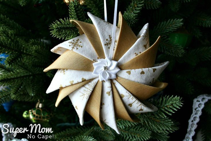 Gold and white Prairie Point Star Ornament with pretty ribbon flower center