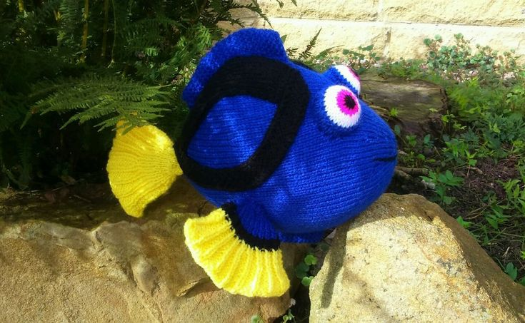 DORY FISH KNITTING PATTERN The pattern is supplied as a print out on 6 x A4 sheets of white paper and placed in a plastic covering. The fins and tail are knitted in double thickness to give a good structure and a top quality feel to the finished product.  Row by row instructions are given for each piece required and step by step tips on how to put them together.  The finished article is approximately 28cm length x 20cm height