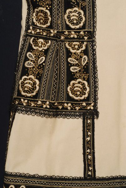 Bridal costume with sigouni (sleeveless woollen coat) detail: Vertical embroidery of the back from the height of the waist to the bottom , Attica