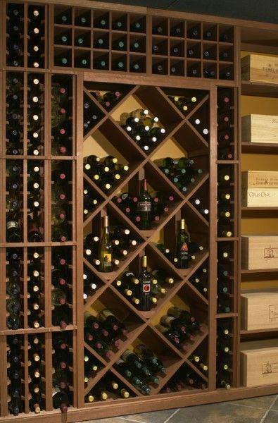 Bin & individual wine racks effectively store wine in this wine cellar.
