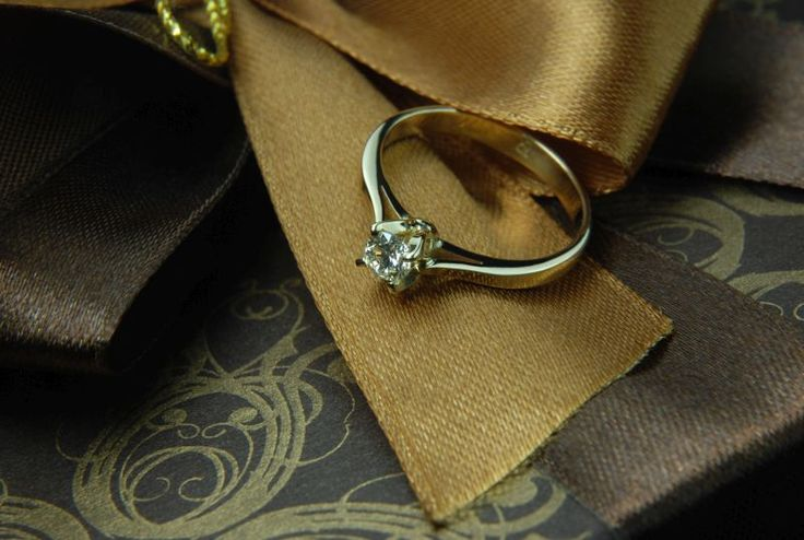 Engagement diamond set in handcrafted yellow gold setting.