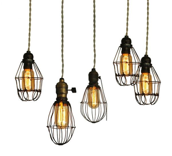 Reproduction Edison filament lightbulbs in antique cages with braided metallic cables. Awesome.