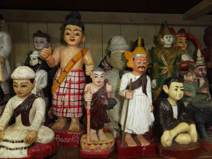Nat figures in an antique shop, Yangon Myanmar