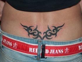 http://www.tattoofav.com Lower Back Tribal Tattoo Sample Designjpg