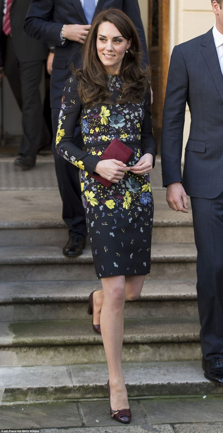 Kate carried a small burgundy clutch by Mulberry, which she teamed with Tod's shoes in a m...