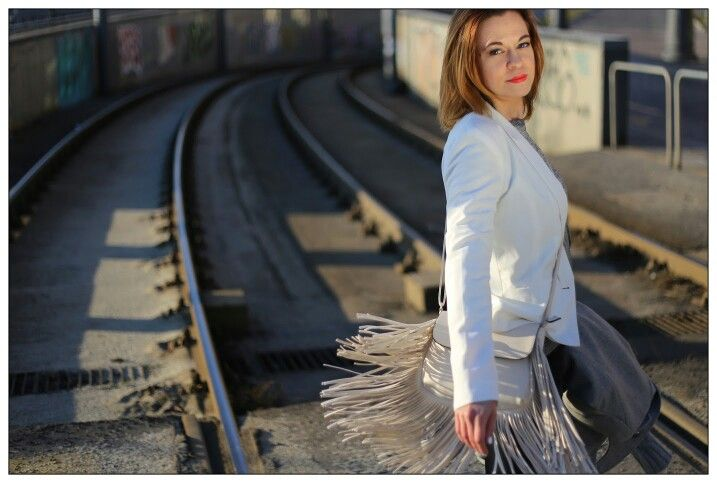 White grey outfit,red lips, auburn balayage hair and fringe bag
