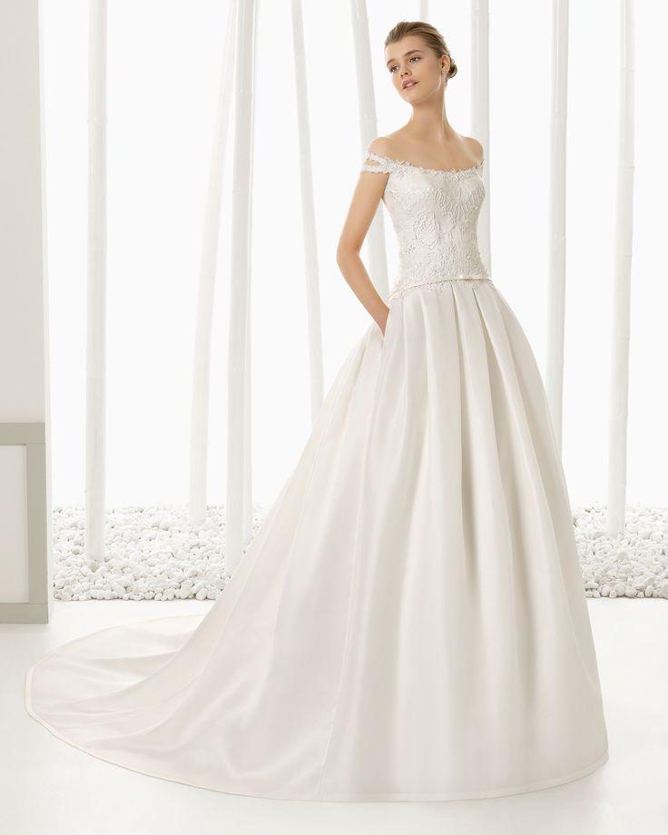 DIANA vestido de novia en encaje pedrería y organza de seda.