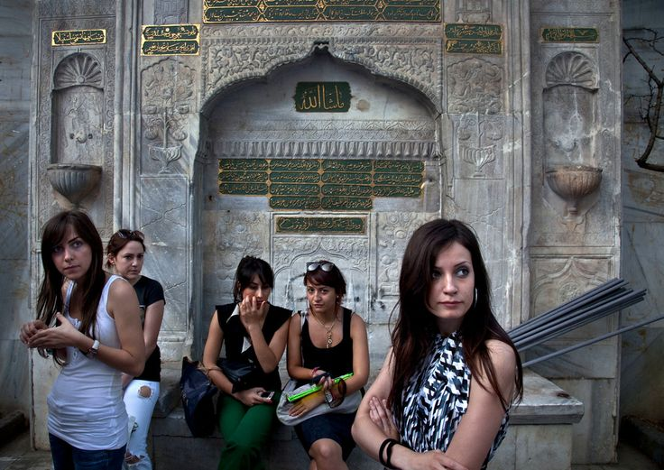 Magnum Photos -  Bruno Barbey View profile TURKEY. Istanbul. Galata Tower, Girls watching a fashion show in front of a 16th century Ottoman fountain.