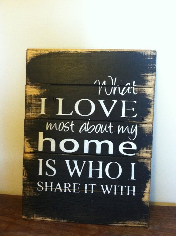 """What I love most about my home is who I share it with 13""""w x17 1/2""""h Hand-painted wood sign on Etsy, $24.00"""