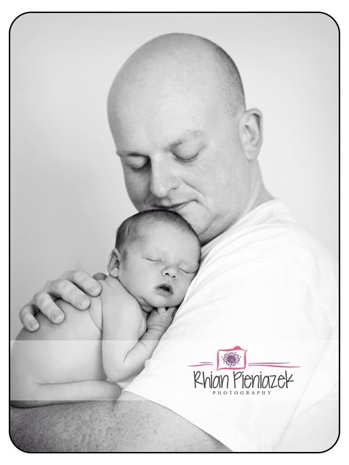 Families. Father and daughter. New dad. Rhian Pieniazek Photography.