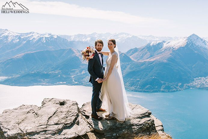 Spring Heli Wedding, Bride and groom on The Ledge
