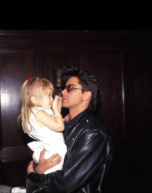 John Stamos (Uncle Jesse) and Ashley Olsen (Michelle Tanner) behind the scenes of Full House.
