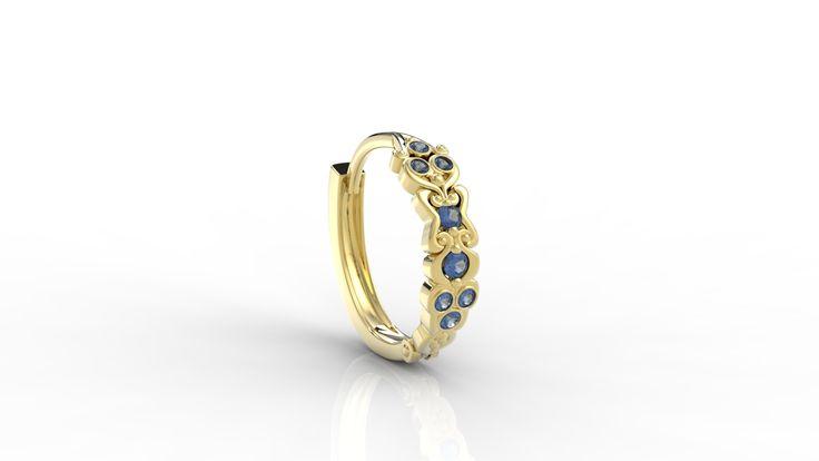 Złoty kolczyk z różnymi kamieniami. / Gold earring with a lot of diamons in difrerent colours.  #project