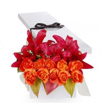 A box of Rana consists of six #flowers of #pink #stargazer with a dozen of #orange #roses for your friend.