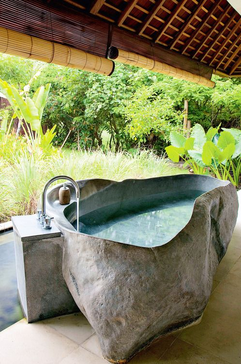 """This site claims this is a """"stone"""" bath.... looks more like sculpted concrete to me..."""