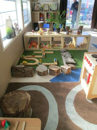 Natural emphasis childcare rooms - could be a fun rock area for building…