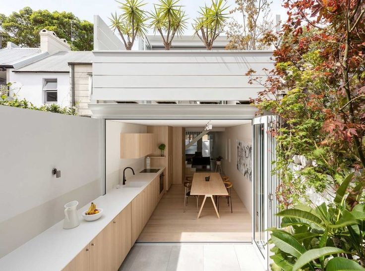 Indoor-outdoor kitchen design in a remodeled house in Sydney by Benn + Penna Architecture | Remodelista