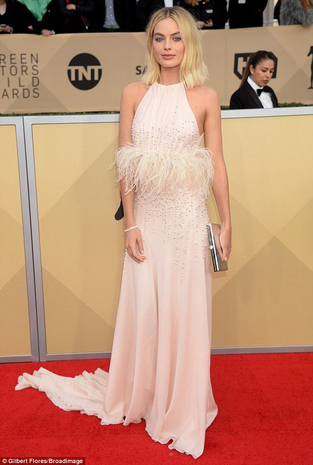 Bird of a feather! Margot Robbie, 27, channeled old Hollywood glamour in an embellished dusty pink frock, as she arrived at the SAG Awards on Sunday