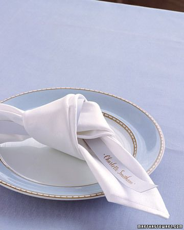 Knot folding in table setting.