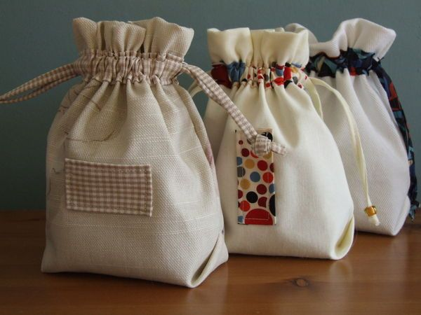 Easy little pouches made from a design I found in a Japanese craft book. These can be made in different sizes and could be used in so many different ways - dressy fabric and longer ties for an...