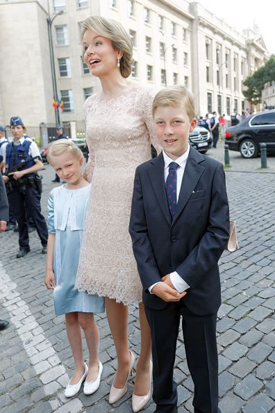 Queen Mathilde, who looked chic in a peach lace dress and matching heels, was joined by her youngest, Princess Eleonore and Prince Emmanuel at National Day celebrations