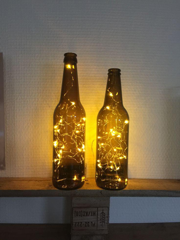 Flaske med lys i.