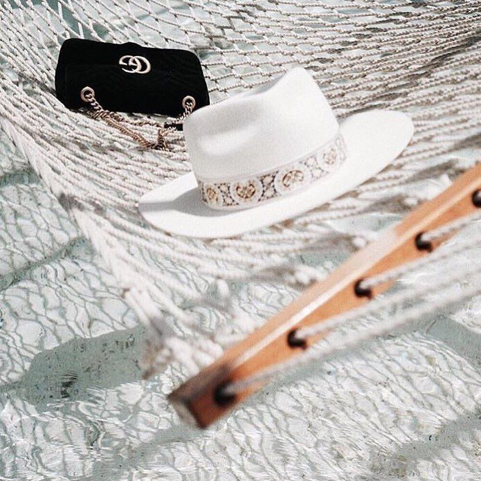 ESSENTIALS   All you need this summer, your @gucci bag, a hat and a hammock swinging over the ocean.   image via @jimsandkittys   #summer #vacation #holiday #gucci #hat #ocean #sun #honeymoon  #Regram via @chosenbyoneday
