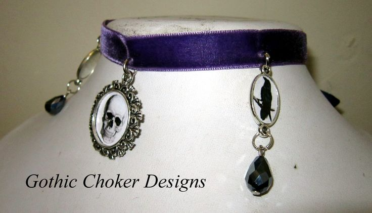 Purple velvet choker with skull cameo in the centre and a raven cameo with a glass black bead on each side. R120 approx $12.  Purchase here: https://hellopretty.co.za/gothic-choker-designs/purple-velvet-choker-with-skull-and-ravens