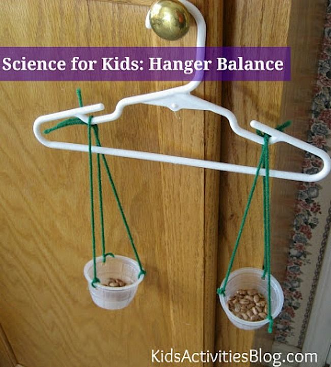 Science for Kids: Teach balance with a hanger!   We used a variety of different materials that we weighed. We also charted the results and compared with each other.