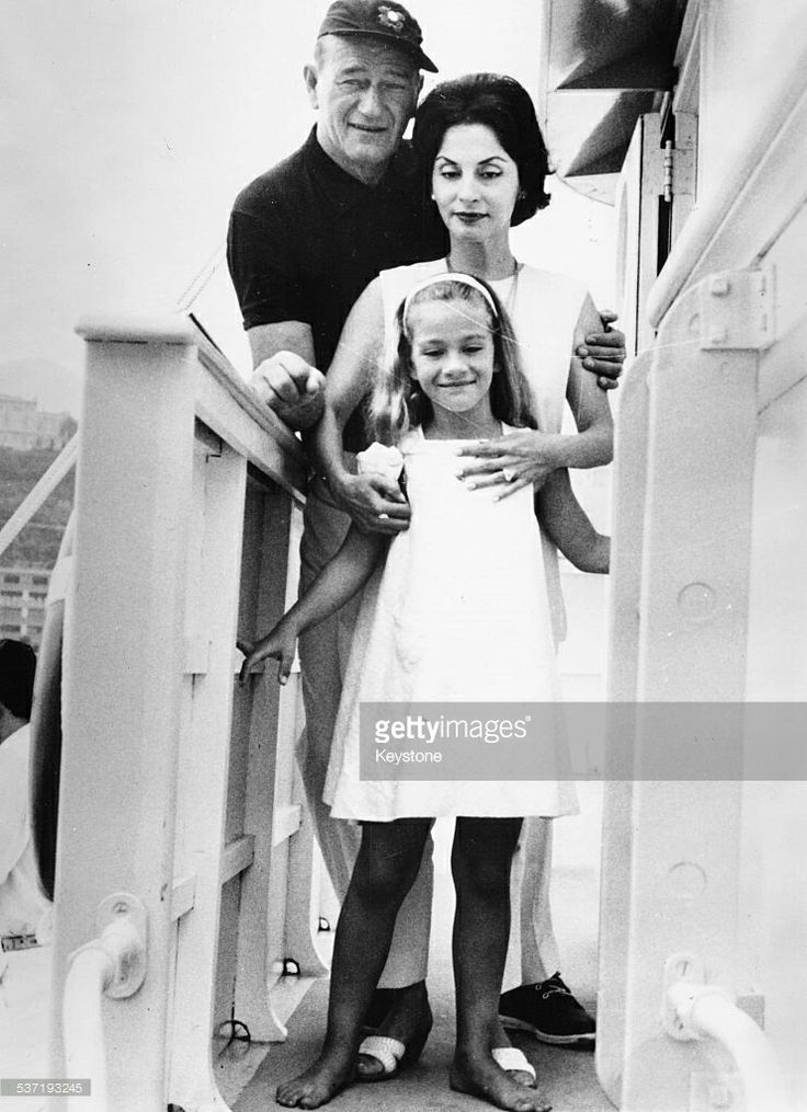 John and Pilar Pallete Wayne and their daughter Marisa on his Yacht the Wild Goose