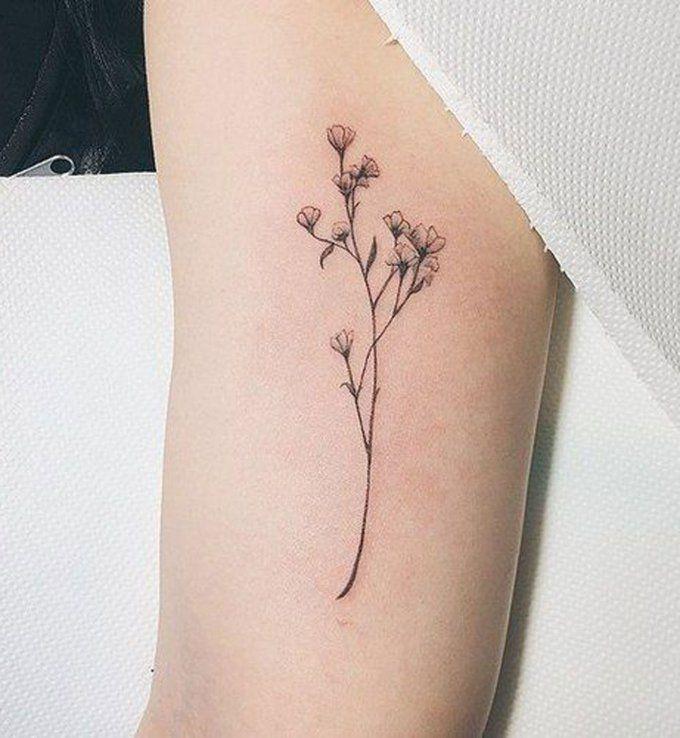 Des Petites Fleurs A L Interieur Du Bras Tatoo Tatouage